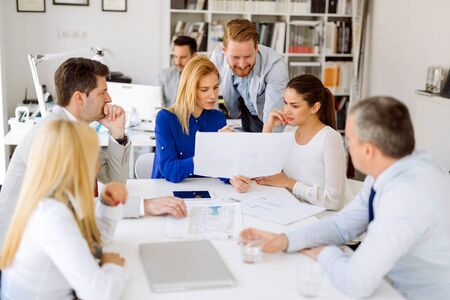 executive women: Business people working in office and brainstorming