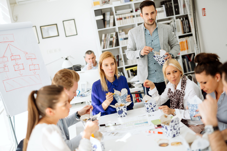 Business people eating meals in office