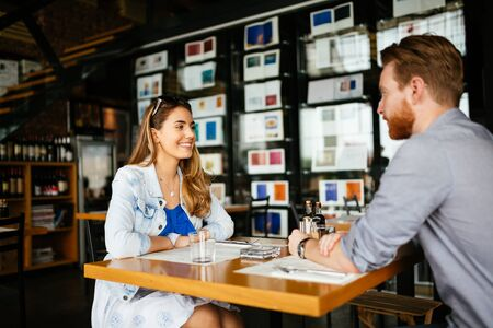 couple dating: Couple dating in restaurant and enjoying each others company Stock Photo