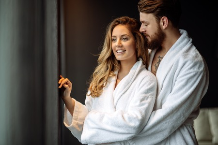 bathrobes: Couple in bathrobes enjoying honeymoon in spa resort