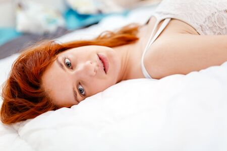 young adult woman: Portrait of a beautiful ginger woman  artistic look
