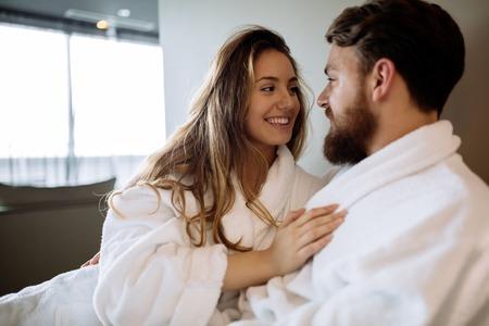 Couple in bathrobes enjoying wellness weekend