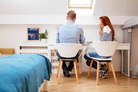 nicely: Beautiful couple working from clean nicely designed home