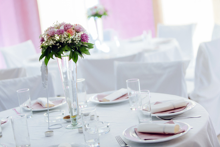 Beutiful wedding setting with flower bouquet on table