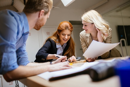 planing: Creative workers designing and planing together in workshop Stock Photo