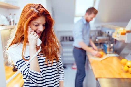 gorgeus: Gorgeus ginger woman talking on phone in kitchen