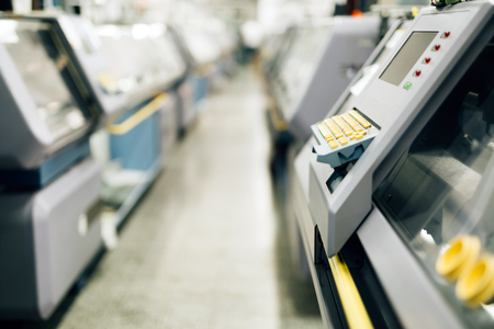 computerized: Computerized knitting machines in textile factory