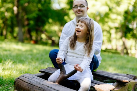 playgroup: People with down syndrome having fun outdoors and smiling Stock Photo