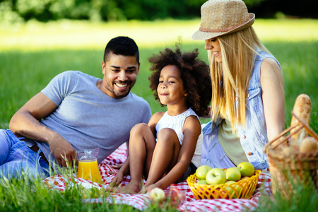 picnicking: Family picnicking outdoors with their cute daughter