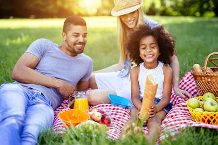 Family picnicking outdoors with their cute daughter Stok Fotoğraf - 59587052