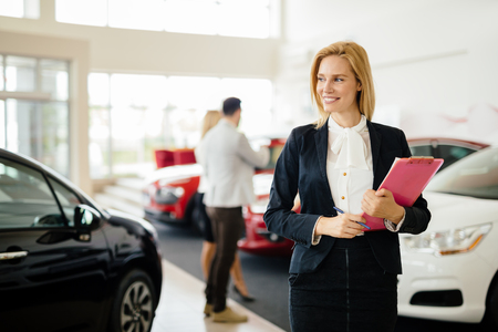 Professional salesperson working in car dealership