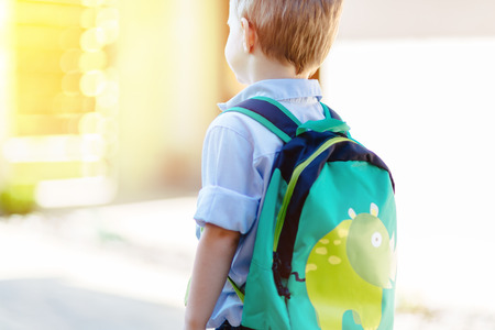 Child leaving home to his first day of kindergarten Stock Photo