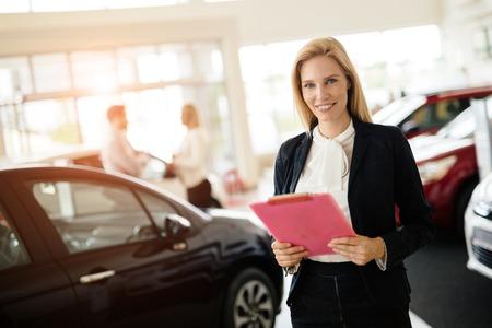 Professional salesperson working in car dealership