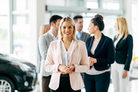 salespeople: Team of professional salespeople at car dealership