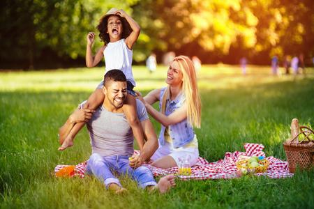 fun activity: Family enjoying picnicking in nature