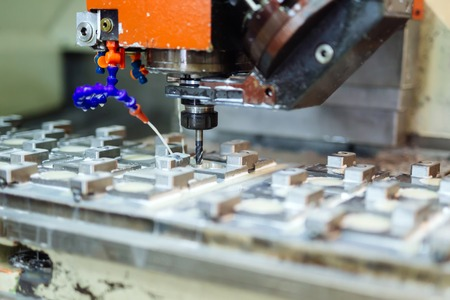 Automated drilling machines processing metalwork for assembly robots Reklamní fotografie