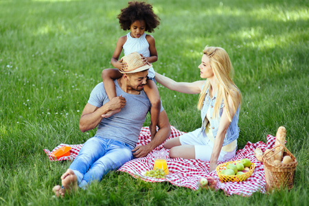 picnicking: Cheerful happy family picnicking on a beautiful day