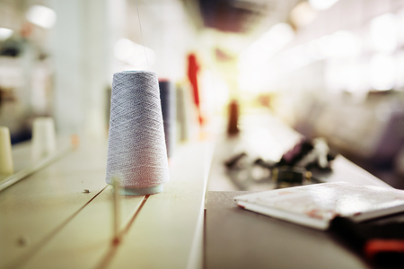 textile industry: Wool and thread spools on desk used in textile industry