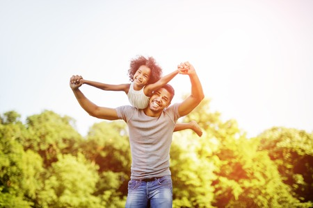 Father carrying daughter piggyback and being truly happy Stockfoto