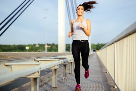 stay beautiful: Beautiful woman jogging to stay fit