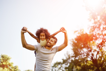 truly: Father carrying daughter piggyback and being truly happy Stock Photo