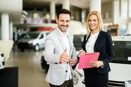 salesperson: Professional salesperson working in car dealership
