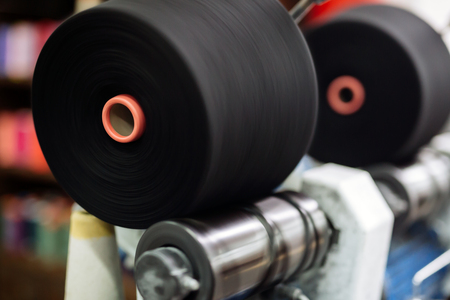 textile industry: Spinning fabric spools in textile industry Stock Photo