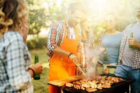 barbecuing: Young people enjoying barbecuing