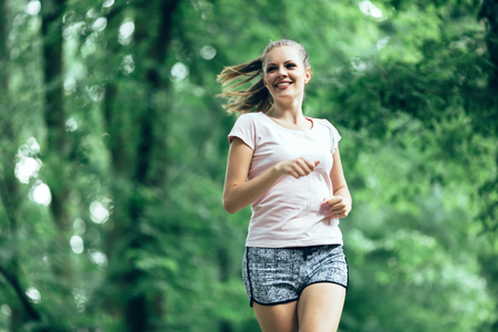 jogger: Beautiful athletic  female jogger in nature Stock Photo