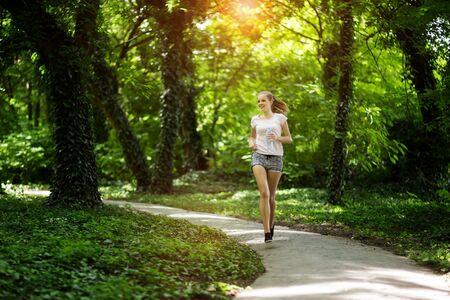 female jogger: Beautiful athletic  female jogger in nature Stock Photo