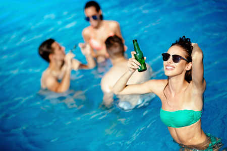 people partying: Group of happy people partying in pool