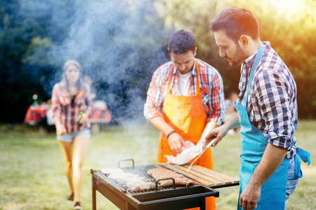 Young people enjoying barbecuing