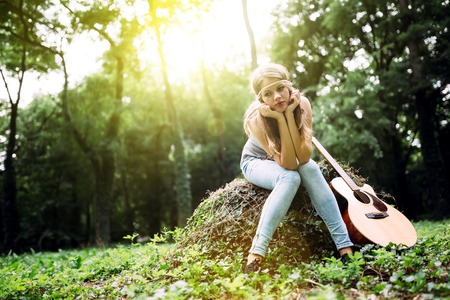 Depressed girl filling void after breakup in nature Stock Photo
