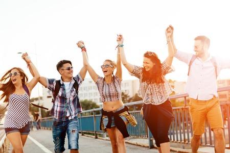 Happy energetic, young people having fun Standard-Bild
