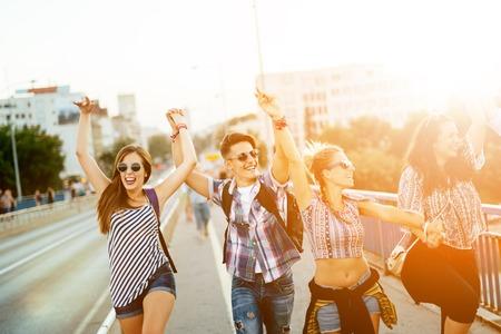 Happy energetic, young people having fun 写真素材