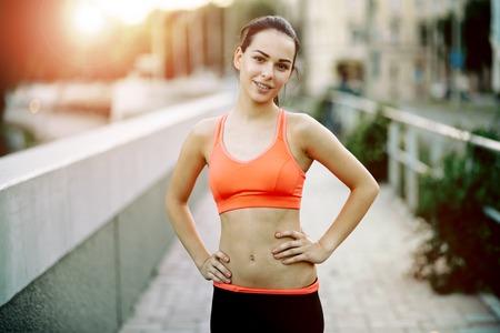 jogger: Happy sporty female jogger smiling Stock Photo