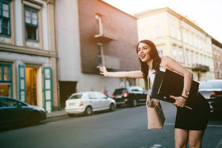 catching taxi: Businesswoman catching a taxi by waving