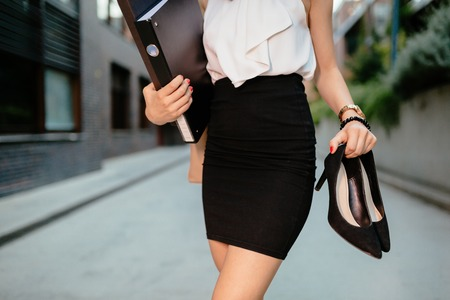 Businesswoman finished working going home Stock Photo