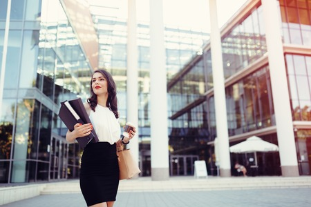skillful: Busy businesswoman in front of building