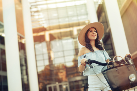 means of transport: Beautiful woman using bicycle as means of transport