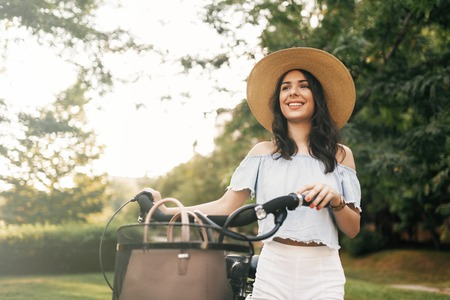 means of transportation: Attractive woman using bicycle as means of transportation Stock Photo