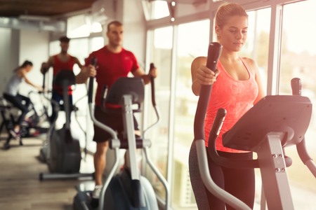 People cardio workout in gym Stock Photo