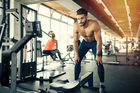 tired person: Exhausted athlete working out in gym