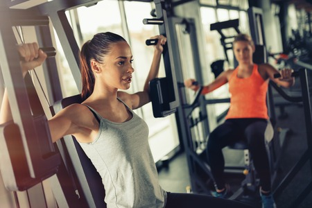 strengthening: Women working out in gym strengthening their physique Stock Photo