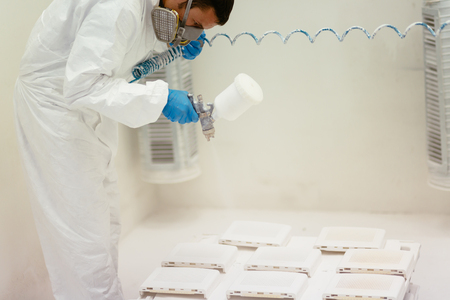 airbrush: Painter using airbrush to paint wearing protective clothing Stock Photo
