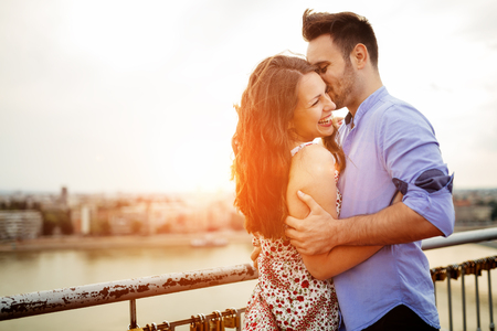 affectionate: Couple in love hugging outdoors and sharing true emotions Stock Photo