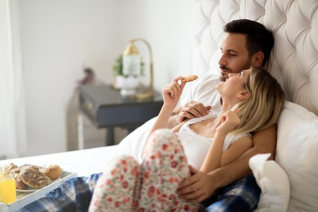 Romantic loving couple in morning in bed Stock Photo