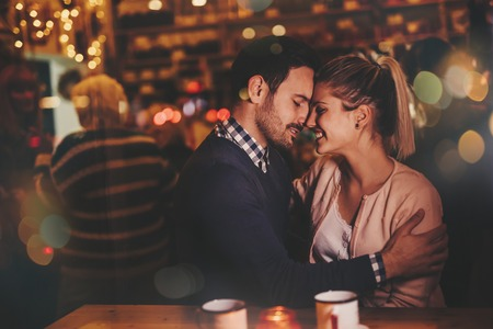 couple dating: Romantic couple dating at night in pub
