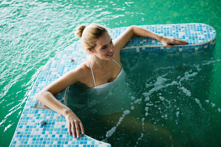 woman bath: Woman relaxing in spa pool with bubble bath
