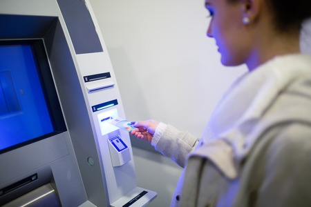 withdrawing: Withdrawing money from ATM with credit card